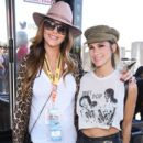 Courtney Sixx and Brittany Furlan attend the Monster Energy NASCAR Cup Series race at Auto Club Speedway at Auto Club Speedway on March 17, 2019 in Fontana, California