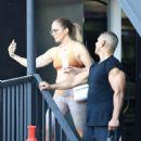 Jennifer Lopez in Orange Sports Bra and Leggings – Leaves a workout in Brentwood