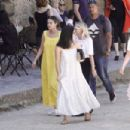 Selena Gomez in Long Yellow Dress – Arrives on a helicopter in Civita di Bagnoregio