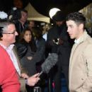 Nick Jonas attends DirecTV Super Saturday Night hosted by Mark Cuban's AXS TV and Pro Football Hall of Famer Michael Strahan at Pendergast Family Farm on January 31, 2015 in Glendale, Arizona
