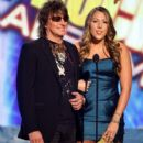 Richie Sambora and Colbie Caillat onstage during the 2008 American Music Awards on November 23, 2008 in Los Angeles, CA - 396 x 594