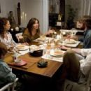 Maya Rudolph (left), Maggie Gyllenhaal (center left), John Krasinski (center right), and Josh Hamilton (right) star in director Sam Mendes' AWAY WE GO, a Focus Features release.
