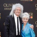 Brian May and Anita Dobson attend The Olivier Awards with Mastercard at Royal Albert Hall on April 8, 2018 in London, England - 396 x 600