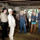 L-r: M.C. GAINEY as Roscoe P. Coltrane, BURT REYNOLDS as Boss Hogg, WILLIE NELSON as Uncle Jesse, JESSICA SIMPSON as Daisy Duke, SEANN WILLIAM SCOTT as Bo Duke and JOHNNY KNOXVILLE as Luke Duke in Warner Bros. Pictures' and Village Roadshow Pictures&#