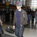 Joseph Gordon Levitt Catching A Flight At LAX
