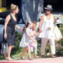Pregnant actress Halle Berry takes her daughter Nahla to the Universal Studios Theme Park in Los Angeles, California for a day of fun with friends on August 6, 2013