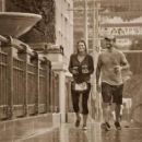 CM Punk and Lita walking in the rain - 454 x 255