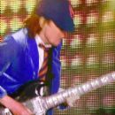 Musician Angus Young of AC/DC performs onstage with Guns N' Roses during day 2 of the 2016 Coachella Valley Music & Arts Festival Weekend 1 at the Empire Polo Club on April 16, 2016 in Indio, California. - 399 x 600