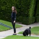 Troian Bellisario – Out for a walk with her dog in Los Angeles - 454 x 443