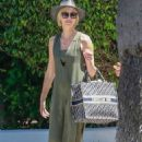 Charlize Theron – Leaving a gas station in Los Angeles