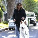 Billy Ray Cyrus takes his dogs out for a relaxing stroll through his neighborhood in Toluca Lake, California on April 4, 2014 - 454 x 589