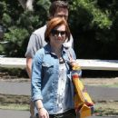 Couple Alyson Hannigan and Alexis Denisof spend some time together at a park in Brentwood, California on July 17, 2015 - 446 x 600