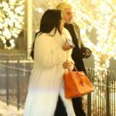 Demi Lovato in White Fur Coat with Henri Levy – Out in Aspen - 454 x 681