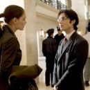 KATIE HOLMES as Rachel Dawes and CILLIAN MURPHY as Dr. Jonathan Crane in Warner Bros. Pictures action adventure Batman Begins, starring Christian Bale.