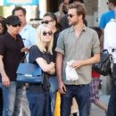 A smitten looking Dakota Fanning and her boyfriend Jamie Strachan go hand in hand for a stroll around New York City - 401 x 594