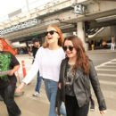 Maisie Williams and Sophie Turner arrive at LAX (Los Angeles International Airport)