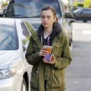 Lily Collins in Tights grab an iced tea in Beverly Hills