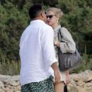 Ronaldo cuts a casual figure in white shirt and green shorts as he enjoys romantic holiday to Spanish island with model girlfriend Celina Locks - 454 x 589