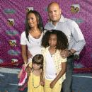 "Melanie Brown, her daughter Phoenix Chi,9, and her husband Stephen Belafonte with his daughter Giselle,4, attended the premiere of the Disney Channel movie ""The Cheetah Girls One World"" in Hollywood."