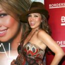 Thalia wears a top with ethnic pattern