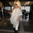Pamela Anderson Departing LAX February 28. 2012