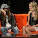 "Musician/filmmaker Rob Zombie and Sheri Moon Zombie Visit Fuse TV's ""Let It Rock"" show at fuse Studios on August 20, 2009 in New York, New York."