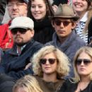 Leonardo DiCaprio and his friend Lukas Haas attend the French tennis Open round of 16 match at the Roland Garros stadium in Paris. Jo-Wilfried Tsonga of France plays against Viktor Troicki of Serbia, and Roger Federer of Switzerland over Gilles Simon of F