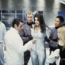 Molay (Arnold Vosloo, far left) and Brinkman (Ian McShane) inform Ronica (Angie Harmon) and Natalie (Hilary Duff, far right) of their evil plan for world domination