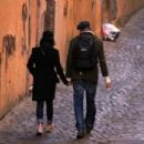 Mila Kunis and Ashton Kutcher: take a romantic stroll around the Trastevere area of Rome at dawn