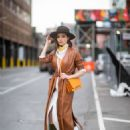 Olivia Culpo in Brown Leather Coat – Out in New York