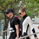 Jennifer Lopez holds hands with boyfriend Casper Smart as she leaves her Miami Beach hotel