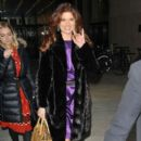 "Debra Messing makes her way out of the Time Life building in New York after an appearance on ""Live With Kelly"""