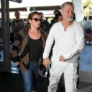 Eddie Van Halen and Jane Liszewski seen at LAX - 400 x 600