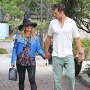 Pregnant singer Fergie and her husband Josh Duhamel attending church in Brentwood, California on August 4, 2013