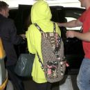 Selena Gomez along with her stepdad, Brian arrive at LAX international airport in Los Angeles, CA (July 10)