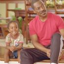 Ben (Khamani Griffin, left) and his father Charlie (Eddie Murphy) enjoy time together