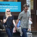 A smitten looking Dakota Fanning and her boyfriend Jamie Strachan go hand in hand for a stroll around New York City - 396 x 594