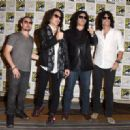 Kiss attends the Scooby-Doo! and Kiss: Rock and Roll Mystery Press Room during Comic-Con International 2015 at the at Hilton Bayfront on July 9, 2015 in San Diego, California. - 454 x 320