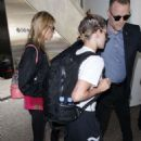 Kristen Stewart and Stella Maxwell – Arriving at LAX Airport in Los Angeles