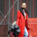 Irina Shayk – In red coat on rainy day in West Village in New York