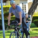Josh Duhamel is spotted enjoying a bicycle ride with his growing son Axl on January 8, 2016 in Brentwood - 448 x 600