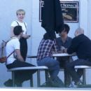 Miley Cyrus chats with a few friends outside of a Los Angeles, California recording studio on Janaury 14, 2014