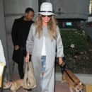 Chrissy Tiegen arriving on a flight at LAX airport in Los Angeles, California with their dogs on January 9, 2015