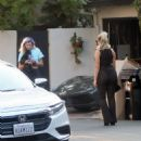 Bebe Rexha – Gets a New Ferrari Delivered to Her Home in Los Angeles