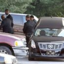 Bobbi Kristina's casket is seen being removed from a hearse and carried into the St. James United Methodist Church ahead of her funeral services on August 1, 2015 in Alpharetta, Georgia - 454 x 303