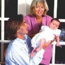 Paul Hill, Courtney Kennedy Hill and their daughter - 288 x 470