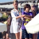 Kate Moss grabbing lunch with Jean-Yves Le Fur and family at Club 55 in St. Tropez (July 8)