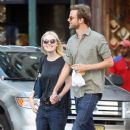 A smitten looking Dakota Fanning and her boyfriend Jamie Strachan go hand in hand for a stroll around New York City - 379 x 594