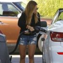 Christine Ouzounian stops to fill up her new Lexus in Newport Beach, California on August 13, 2015 - 425 x 600