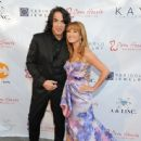 Musician Paul Stanley of KISS and Jane Seymour attend the 5th Annual Open Hearts Foundation Gala on May 9, 2015 in Malibu, California. - 444 x 600